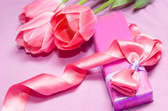 Tulips and gift box with ribbon Stock Image