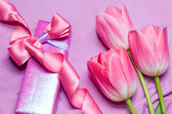 Tulips and gift box with ribbon Stock Photography