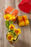 Tulips and gift boxes Royalty Free Stock Image