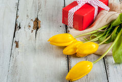 Tulips and gift for Valentine`s day Royalty Free Stock Photo