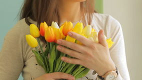 Tulips in girl`s hands. Video of tulips in girl`s hands stock video