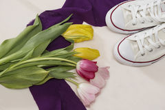 Tulips and gumshoes. Close up Royalty Free Stock Images