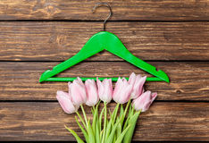 Tulips and hanger Stock Images