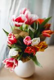 Tulips in a jar. On a table Royalty Free Stock Photo