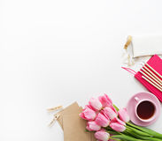 Tulips, keyboard and office supplies on white board Royalty Free Stock Photos
