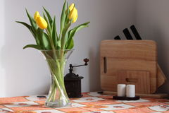 Tulips on kitchen table. Yellow tulips on kitchen table Royalty Free Stock Photos