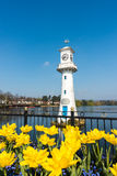 Tulips and Lighthouse at Public Roath Park. Yellow Tulips blooming in front of the Robert Scott Memorial Lighthouse at Roath Park Lake, Cardiff, Wales, UK stock photo