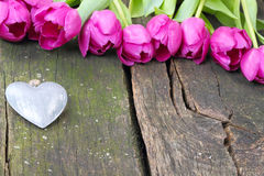 Tulips and little heart on wood Stock Images