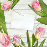 Tulips lying on a white textured table. EPS 10 Stock Photos