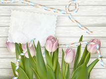 Tulips lying on a white textured table. EPS 10 Royalty Free Stock Photography