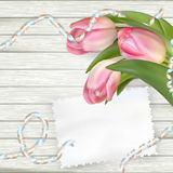 Tulips lying on a white textured table. EPS 10 Royalty Free Stock Photo