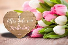 Tulips with message saying `Happy Mother`s Day`. In German royalty free stock photography