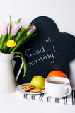 Tulips, morning coffee, fruit and chalk board Royalty Free Stock Image