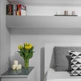 Tulips on nightstand Royalty Free Stock Image
