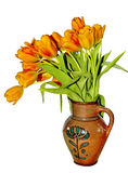 Tulips in old clay jug Stock Photos