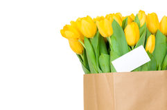 Tulips in the paper bag with greeting card Royalty Free Stock Photos