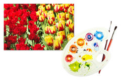 Tulips on a paper with palette and paintbrushes Royalty Free Stock Photo