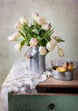 Tulips and Pears. Still Life with Tulips in old milk can and Pears Royalty Free Stock Image
