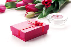 Tulips and present. Romantic present with tulips and candle Stock Photo