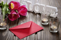 Tulips and red envelope Stock Images