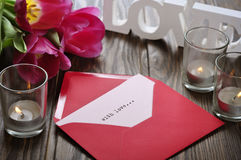 Tulips and red open envelope Royalty Free Stock Image