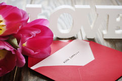 Tulips and red open envelope Stock Images