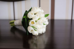 Tulips on a reflective table. Picture of beautiful  white tulips on a reflective table. Side view Royalty Free Stock Image