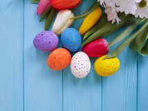 Tulips roses easter eggs basket on blue wooden postcard beautifu. L bouquet Stock Photos