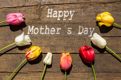 Tulips on rustic wooden Background and text Happy mother´s Day Royalty Free Stock Photography