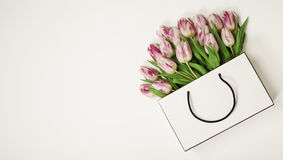 Tulips in shopping bag Royalty Free Stock Images