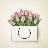 Tulips in shopping bag Royalty Free Stock Image
