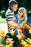 Tulips  spring  positive  love  happiness. Man and woman near tulips spring positive love happiness Royalty Free Stock Images