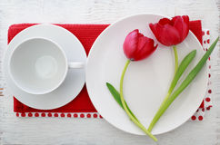 Tulips with table set Stock Photo