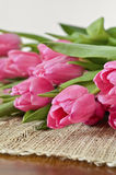 Tulips on a tablecloth Stock Photos