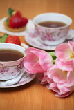 Tulips and tea Royalty Free Stock Photography