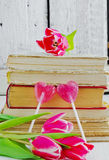 Tulips and valentines on the books Royalty Free Stock Image