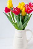 Tulips in vase. Bouquet of red and yellow tulips in vase Stock Photography