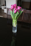 tulips in vase on table Royalty Free Stock Photos