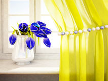 Tulips in a vase on the windowsill Stock Images