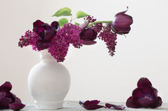 Tulips in  vase on wooden table Stock Photography