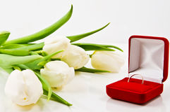 Tulips and wedding ring Stock Image