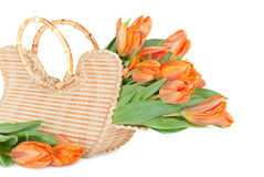 Tulips in the wicker handbag Royalty Free Stock Photography