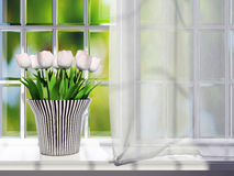 Tulips on a windowsill. Stock Photography