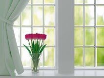 Tulips on a windowsill. Bouquet of pink flowers (tulips) on a windowsill royalty free stock images