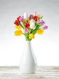 Tulips on wooden background Stock Photography