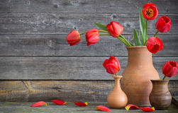 Tulips on wooden table Royalty Free Stock Photo