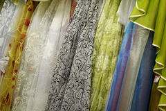 Tulle transparent fabric. It is used for windows. Background. White, yellow, blue, red. Royalty Free Stock Image