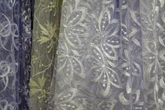 Tulle transparent fabric. It is used for windows. Background. White, yellow. Royalty Free Stock Photo