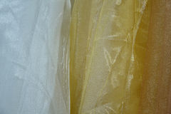 Tulle transparent fabric. It is used for windows. Background. White, yellow, orange. Stock Image