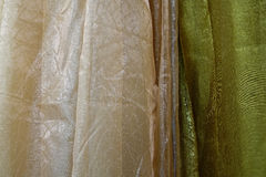 Tulle transparent fabric. It is used for windows. Background. Yellow, orange. Stock Image